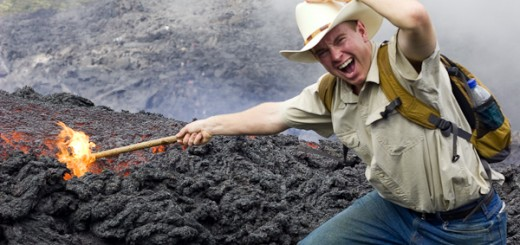 John pushing a stick into Lava on the Pacaya Volcano, Guatemala
