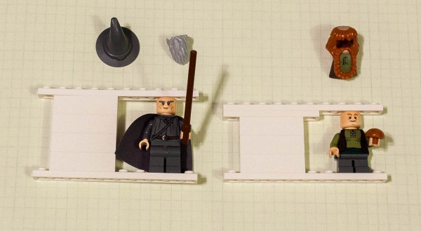 Measuring the height of beardless gandalf and a dwarf friend.