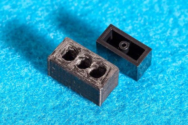Comparing underside of TomBlox and Lego brick