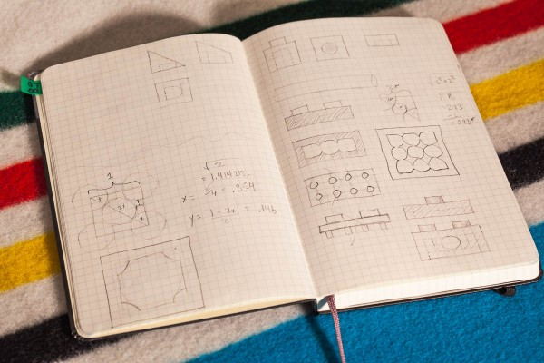 Sketches on graph paper of proposed interlocking block design.