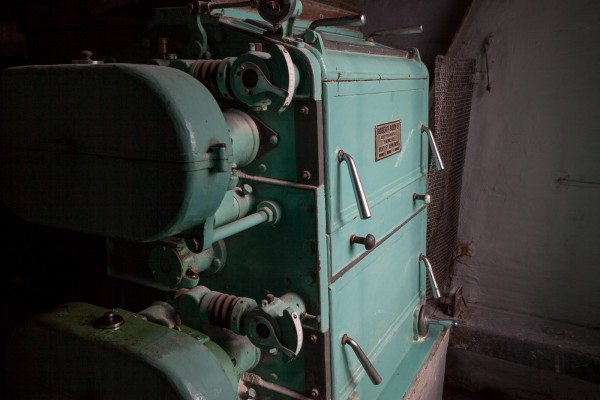 Bruichladdish distillery uses an even older Boby mill, although the principle is the same.  The grain is cracked falling through the first set of rollers, and crushed just right in the second set of rollers.